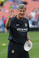 Football - Premier League - Chelsea Training for friendly with Man City St. Louis, MO/USA. Manchester City won, 4-3 over Chelsea. Manchester City head coach Brian Kidd waves to photographers before the game, as he places practice cones on the field...