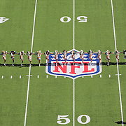 The New York Jets cheers girls performing on The NFL logo and American Football field markings on the surface of MetLife Stadium during the New York Jets V New England Patriots NFL regular season game at MetLife Stadium, East Rutherford, NJ, USA. 20th October 2013. Photo Tim Clayton