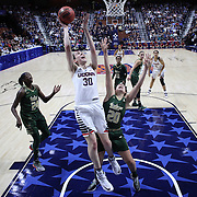Breanna Stewart,  UConn, is fouled by Laura Ferreira, USF, as she scores two points during the UConn Huskies Vs USF  2016 American Athletic Conference Championships Final. Mohegan Sun Arena, Uncasville, Connecticut, USA. 7th March 2016. Photo Tim Clayton