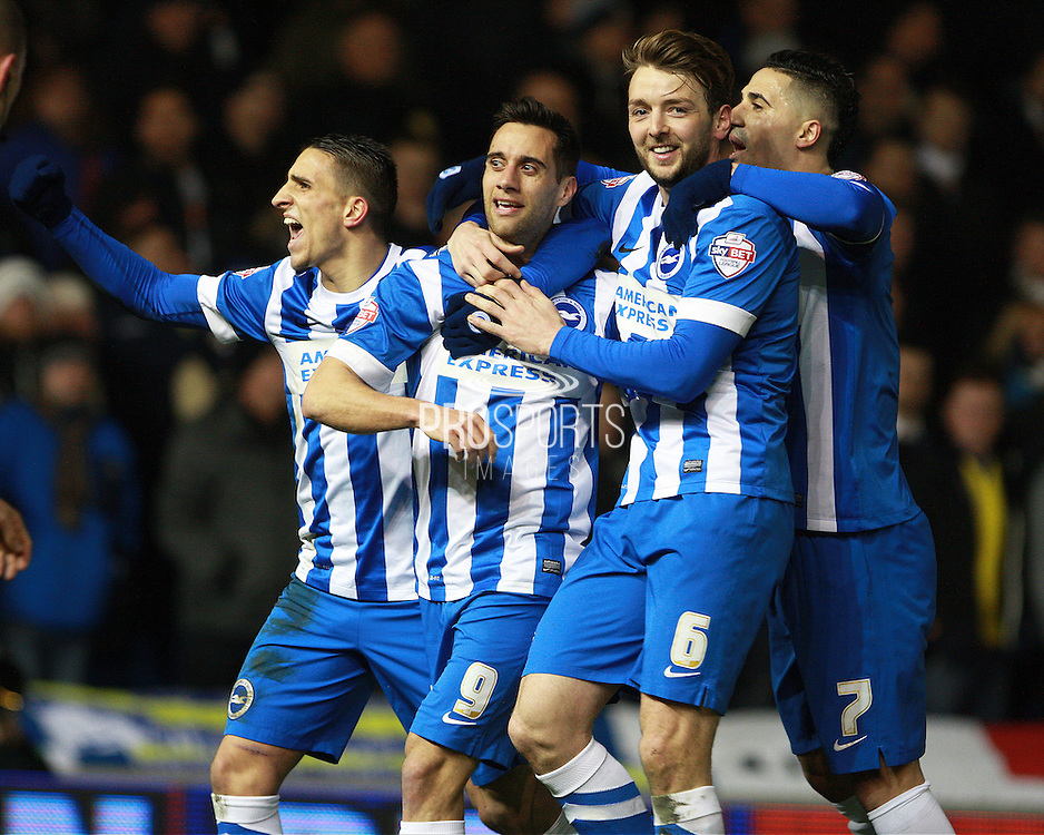 Brighton striker Sam Baldock & Brighton central midfielder Dale Stephens lead the celebrations as Brighton make it 2-0 during the Sky Bet Championship match between Brighton and Hove Albion and Leeds United at the American Express Community Stadium, Brighton and Hove, England on 29 February 2016. Photo by Bennett Dean.