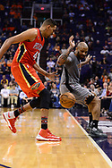 Feb 13, 2017; Phoenix, AZ, USA; New Orleans Pelicans center Alexis Ajinca (42) and Phoenix Suns forward P.J. Tucker (17) watch as the ball goes out of bounds in the first half of the NBA game at Talking Stick Resort Arena. Mandatory Credit: Jennifer Stewart-USA TODAY Sports