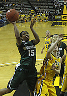 January 27 2010: Michigan St. forward Cetera Washington (15) puts up a shot over Iowa forward Kelsey Cermak (22) during the first half of an NCAA women's college basketball game at Carver-Hawkeye Arena in Iowa City, Iowa on January 27, 2010. Iowa defeated Michigan State 66-64.
