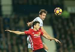 17 December 2016 - Premier League - West Bromwich Albion v Manchester United - Craig Dawson of West Bromwich Albion wins a header from Matteo Darmain of Manchester United - Photo: Paul Roberts / Offside.