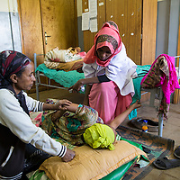Mawerdi Adem, 24, assists a woman who is in obstructed labor at the Jarso heath clinic near Harar, Ethiopia.