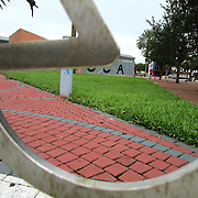 Making use of the photographic composition rule of using frames to frame an image within another frame, the letter A in the outside for MOCA (Museum of Contemporary Art) in North Miami, Florida, is  viewed through a bicycle stand. (Photo by Dafne Parra)