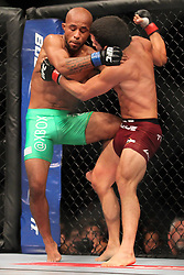 Toronto, Ontario, Canada - September 22, 2012: Joseph Benavidez (Burgundy trunks) and Demetrious Johnson (Green trunks) during UFC 152 at the Air Canada Centre in Toronto, Ontario, Canada.