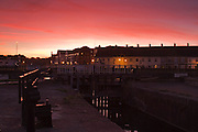 Looking west from the exit of Bridgwater Quay ot the River Parret, towards the Quay itself, as the sun sets.