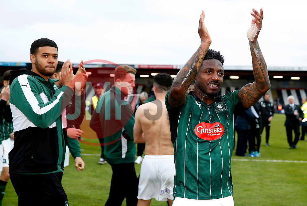 Yann Songo'o of Plymouth Argyle celebrates after achieving promotion to SkyBet League One - Mandatory by-line: Matt McNulty/JMP - 06/05/2017 - FOOTBALL - Blundell Park - Cleethorpes, England - Grimsby Town v Plymouth Argyle - Sky Bet League Two