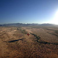 19 May 2005:  Balloons fly across the Sonoran desert near Phoenix, Arizona in the early morning as the sun rises on May 19, 2005.