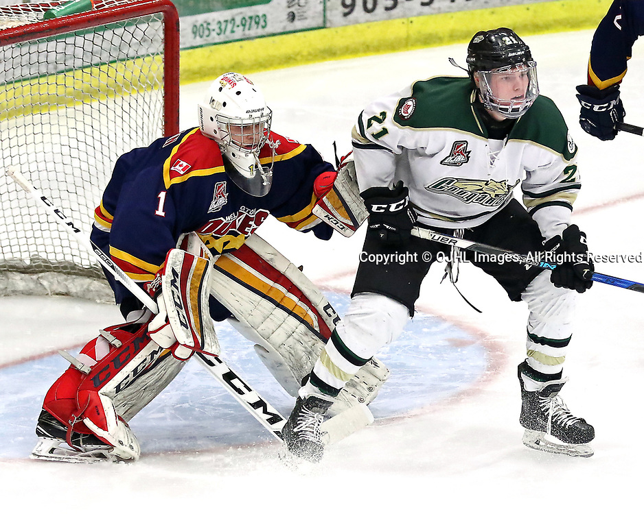COBOURG, ON - MAR 20,  2017: Ontario Junior Hockey League playoff game between  the Cobourg Cougars and the Wellington Dukes , Matthew Carroll #21 of the Cobourg Cougars attempts to screen goaltender during the third period<br /> (Photo by Ed McPherson / OJHL Images)