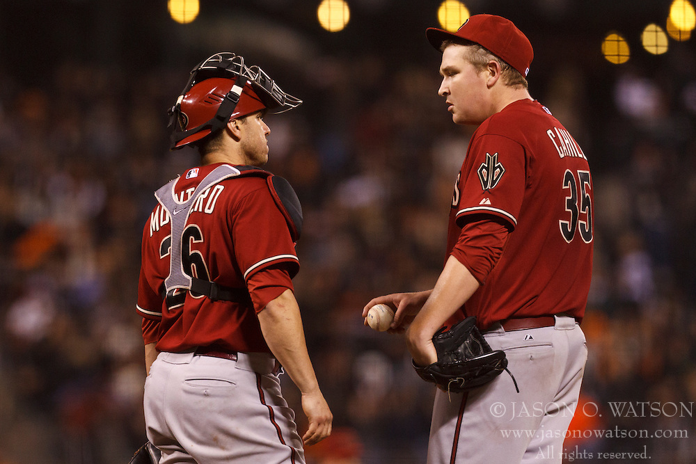 SAN FRANCISCO, CA - SEPTEMBER 05: Miguel Montero #26 of the Arizona Diamondbacks talks to Trevor Cahill #35 on the pitchers mound against the San Francisco Giants during the seventh inning at AT&T Park on September 5, 2012 in San Francisco, California. The Arizona Diamondbacks defeated the San Francisco Giants 6-2. (Photo by Jason O. Watson/Getty Images) *** Local Caption *** Miguel Montero; Trevor Cahill