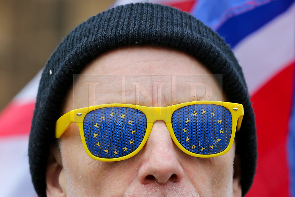 © Licensed to London News Pictures. 19/01/2019. London, UK. An anti-Brexit demonstrator with European Union flag sunglasses protests outside the Houses of Parliament on day three of Meaningful Vote debate and on Tuesday 15 January 2019 the MPs will vote on Prime Minister, Theresa May's Brexit deal. Photo credit: Dinendra Haria/LNP