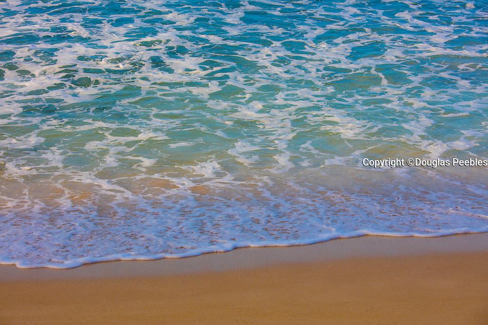 Wave onto beach, Hawaii