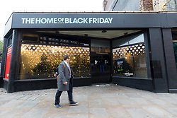 © Licensed to London News Pictures. 23/11/2018. London, UK.  A commuter walks past the Amazon.com Black Friday pop-up shop on Shoreditch High Street in London this morning.  Photo credit: Vickie Flores/LNP
