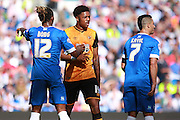 Brighton defender full back Gaetan Bong keeps tight to Hull City striker Chuba Akpom during the Sky Bet Championship match between Brighton and Hove Albion and Hull City at the American Express Community Stadium, Brighton and Hove, England on 12 September 2015. Photo by Bennett Dean.