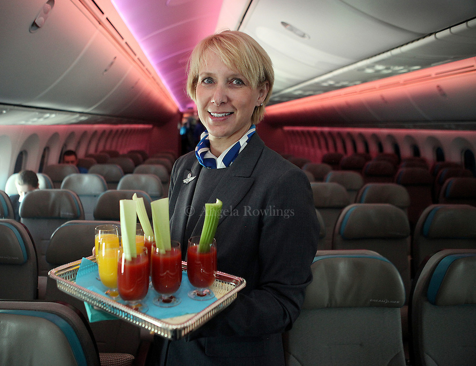 (030512  Boston, MA) Flight attendant Patricia Bennett shows off drinks she's serving on a Boston to Newark flight on the new Boeing 787 Dreamliner, Monday, March 5, 2012.  Staff photo by Angela Rowlings.
