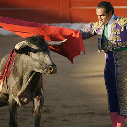 A matador and bloodied bull square-off in Puerto Vallarta, Mexico.