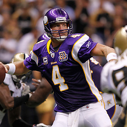 September 9, 2010; New Orleans, LA, USA;  Minnesota Vikings quarterback Brett Favre (4) throws a pass against the New Orleans Saints during the third quarter of the NFL Kickoff season opener at the Louisiana Superdome. Mandatory Credit: Derick E. Hingle