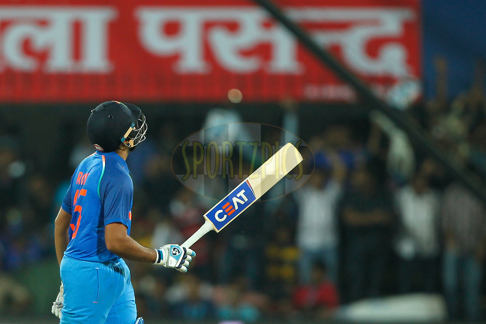 Rohit Sharma of India raises his bat after scoring 50 runs during the 3rd One Day International between India and Australia held at the Holkar Stadium in Indore on the 24th  September 2017<br /> <br /> Photo by Deepak Malik / BCCI / SPORTZPICS