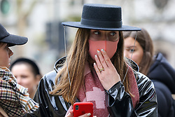 © Licensed to London News Pictures. 14/02/2020. London, UK. A fashion enthusiast wearing fashionable face mask arrives for the London Fashion Week shows in The Strand. The latest Coronavirus patient in London is linked to 'super spreader' attended transport conference with 250 people in Westminster. Photo credit: Dinendra Haria/LNP