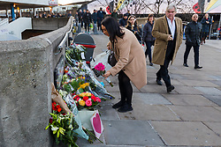 © Licensed to London News Pictures. 02/12/2019. London, UK. A commuter lays flowers on London Bridge. Two victims were died following a terrorist attack near London Bridge on 29th November when police shot dead the attacker. Photo credit: Vickie Flores/LNP