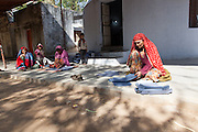 Women making cardboard boxes for sanitary towels, manufactured in a same house behind them, in Barefoot College old campus.  Since 1975, more than 1,850 rural women have trained and worked as Barefoot artisans and weavers. They have made a living by producing rural handicrafts items. 01/2013 © Marida Augusto/Max HIrzel