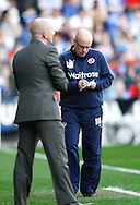 Picture by Andrew Tobin/Focus Images Ltd. 07710 761829. 24/03/12 Brian McDermott (R) takes notes as Ian Holloway (L) looks on during the Npower Championship match at Madejski stadium, Reading.