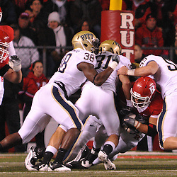 Oct 16, 2009; Piscataway, NJ, USA; Rutgers running back Joe Martinek (38) is gang tackled by the Pittsburgh defense during first half NCAA football action in Pittsburgh's 24-17 victory over Rutgers at Rutgers Stadium.