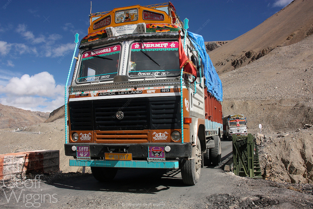 Indian Ashok Leyland truck negotiates narrow bridge in the Himalayan passes on the road to Sarchu, Ladakh, Northern India