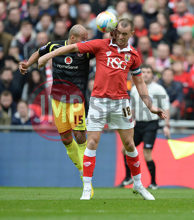 Bristol City's Aaron Wilbraham battles for the ball with Walsall's James Chambers - Photo mandatory by-line: Alex James/JMP - Mobile: 07966 386802 - 22/03/2015 - SPORT - Football - London - Wembley Stadium - Bristol City v Walsall - Johnstone Paint Trophy Final