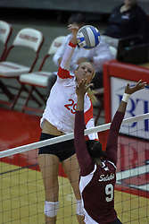 05 November 2010: Mallory Leggett attacks towards the hands of blocker Jasmine Conner during an NCAA volleyball match between the Southern Illinois Salukis and the Illinois State Redbirds at Redbird Arena in Normal Illinois.