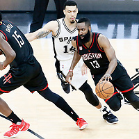 01 May 2017: Houston Rockets guard James Harden (13) drives past San Antonio Spurs guard Danny Green (14) on a screen set bob Houston Rockets center Clint Capela (15) during the Houston Rockets 126-99 victory over the San Antonio Spurs, in game 1 of the Western Conference Semi Finals, at the AT&T Center, San Antonio, Texas, USA.