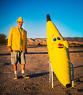 "Fred Garbutt, proprietor and owner of the International Banana Museum on Highway 111 near North Shore. Garbutt opened the business in the last year after purchasing a banana-themed collection. Garbutt acknowledges the wacky nature of his business, but said ""as long as you come give me a dollar I don't give a fuck."""