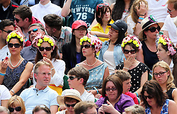 Image ©Licensed to i-Images Picture Agency. 26/06/2014. London, United Kingdom. Tennis fans on Centre Court  on day four of the Wimbledon Tennis Championships. Picture by Stephen Lock / i-Images