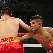 TAMPA, FL - FEBRUARY 28:  Ernesto Garza (L) takes a punch from Neslan Machado during the SoloBoxeo Tecate boxing match at the University of South Florida Sundome on February 28, 2015 in Tampa, Florida. Machado won the bout by decision.  (Photo by Alex Menendez/Getty Images) *** Local Caption *** Ernesto Garza; Neslan Machado