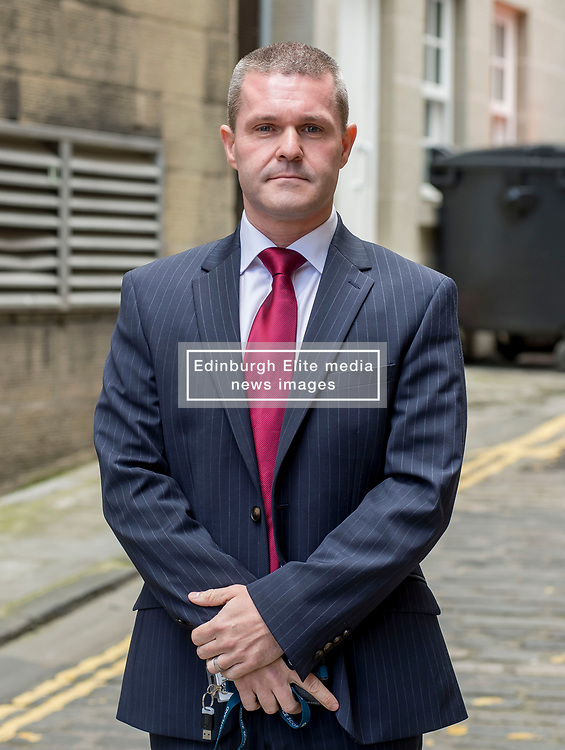Young campaigners hold giant photos covered in crime scene tape to highlight the introduction from today of the Abusive Behavior and Sexual Harm (Scotland) Act 2016, which now makes it a criminal offence to post so caled 'revenge porn' pictures on social media. Pictured is Detective Chief Superintendent Gordon McCreadie from Police Scotland's Domestic Abuse taskforce.<br /> <br /> © Dave Johnston/ EEm