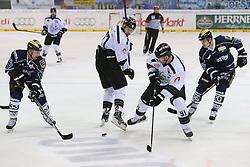02.11.2014, Saturn Arena, Ingolstadt, GER, DEL, ERC Ingolstadt vs Thomas Sabo Ice Tigers, 16. Runde, im Bild Kampf um den Puck: Bjoern Barta (Nr.33, ERC Ingolstadt), Marius M??chel (Nr.77, Thomas Sabo Ice Tigers), Marc El-Sayed (Nr.91, Thomas Sabo Ice Tigers) und Marc Schmidpeter (Nr.19, ERC Ingolstadt) // during Germans DEL Icehockey League 16th round match between ERC Ingolstadt and Thomas Sabo Ice Tigers at the Saturn Arena in Ingolstadt, Germany on 2014/11/02. EXPA Pictures © 2014, PhotoCredit: EXPA/ Eibner-Pressefoto/ Strisch<br /> <br /> *****ATTENTION - OUT of GER*****