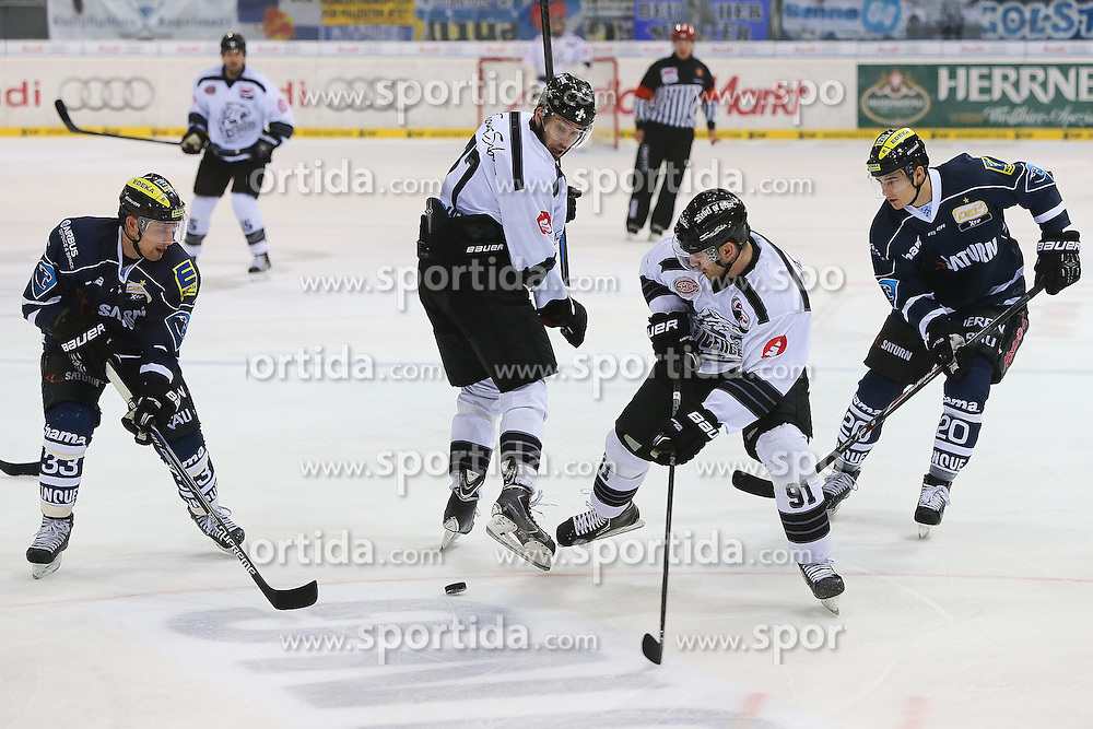 02.11.2014, Saturn Arena, Ingolstadt, GER, DEL, ERC Ingolstadt vs Thomas Sabo Ice Tigers, 16. Runde, im Bild Kampf um den Puck: Bjoern Barta (Nr.33, ERC Ingolstadt), Marius M??chel (Nr.77, Thomas Sabo Ice Tigers), Marc El-Sayed (Nr.91, Thomas Sabo Ice Tigers) und Marc Schmidpeter (Nr.19, ERC Ingolstadt) // during Germans DEL Icehockey League 16th round match between ERC Ingolstadt and Thomas Sabo Ice Tigers at the Saturn Arena in Ingolstadt, Germany on 2014/11/02. EXPA Pictures © 2014, PhotoCredit: EXPA/ Eibner-Pressefoto/ Strisch<br /> <br /> *****ATTENTION - OUT of GER*****