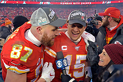 Jan 19, 2020; Kansas City, Missouri, USA; Kansas City Chiefs tight end Travis Kelce (87) and quarterback Patrick Mahomes (15) are interviewed after beating then Tennessee Titans in the AFC Championship Game at Arrowhead Stadium. Mandatory Credit: Denny Medley-USA TODAY Sports