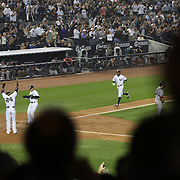 Curtis Granderson, New York Yankees, heads to home plate after hitting the first of his two home runs during the New York Yankees V Boston Red Sox Baseball game which the Yankees won 14-2 to become American League East champions at Yankee Stadium, The Bronx, New York. 4th October 2012. Photo Tim Clayton