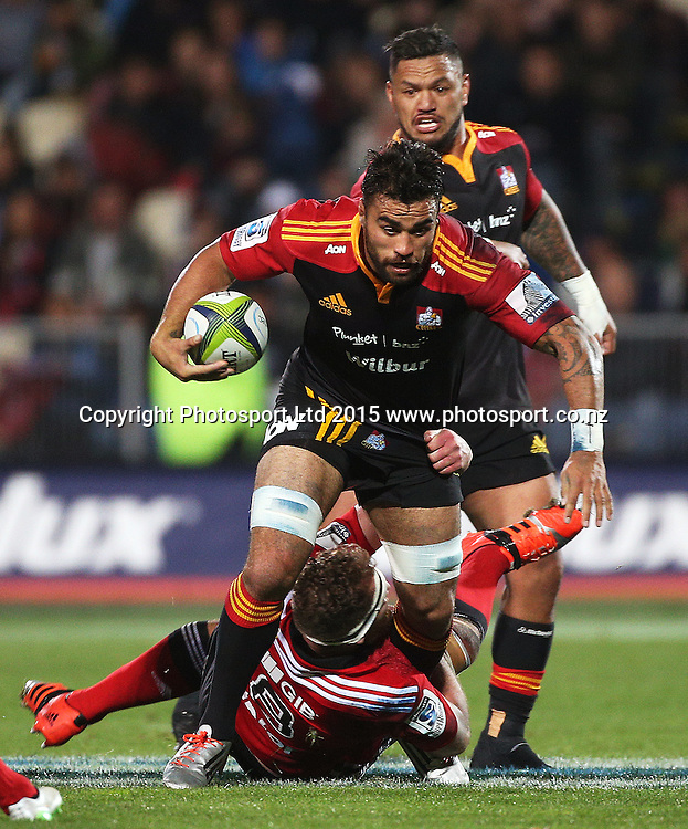Liam Messam of the Chiefs with the ball is tackled by Kieran Read of the Crusaders during the Investec Super Rugby game between the Crusaders v Chiefs at AMI Stadium i Christchurch. 17 April 2015 Photo: Joseph Johnson/www.photosport.co.nz