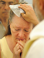 Kathy McCouch of Glenside, Pennsylvania is touched on the forehead by Padre Pio Mandato as he holds a glove once worn by Padre Pio during the Healing Service, which was part of the first annual Padre Pio Festival at St. Bede the Venerable Church Sunday June 26, 2016 in Northampton, Pennsylvania. (Photo by William Thomas Cain)