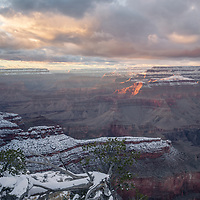 Sunset light and snow at Yavapai Point, Grand Canyon National Park, AZ