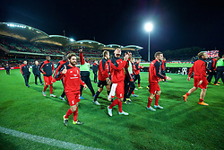 ADELAIDE, AUSTRALIA - Monday, July 20, 2015: Liverpool's Joe Allen and Dejan Lovren applaud the supporters after the 2-0 victory over Adelaide United during a preseason friendly match at the Adelaide Oval on day eight of the club's preseason tour. (Pic by David Rawcliffe/Propaganda)
