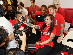 KUALA LUMPUR, MALAYSIA - Wednesday, July 22, 2015: A Liverpool supporter takes a selfie with players Nathaniel Clyne and Alberto Moreno during an event at the Mid Valley Mega Mall on day ten of the club's preseason tour. (Pic by David Rawcliffe/Propaganda)