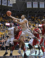 WICHITA, KS - NOVEMBER 12:  Guard Fred VanVleet #23 of the Wichita State Shockers drives in for a score against the Western Kentucky Hilltoppers during the first half on November 12, 2013 at Charles Koch Arena in Wichita, Kansas.  (Photo by Peter Aiken/Getty Images) *** Local Caption *** Fred VanVleet