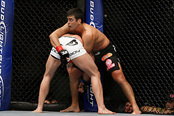 October 24, 2009; Los Angeles, CA; USA; Lyoto Machida (black trunks) defends a takedown attempt from Mauricio Rua(white trunks) during their UFC light heavyweight championship bout at UFC 104.   Machida won via controversial unanimous decison .  Mandatory Credit:  Ed Mulholland