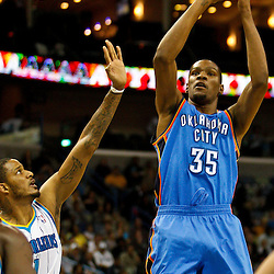 January 24,  2011; New Orleans, LA, USA; Oklahoma City Thunder small forward Kevin Durant (35) shoots over New Orleans Hornets small forward Trevor Ariza (1) during the fourth quarter at the New Orleans Arena. The Hornets defeated the Thunder 91-89. Mandatory Credit: Derick E. Hingle