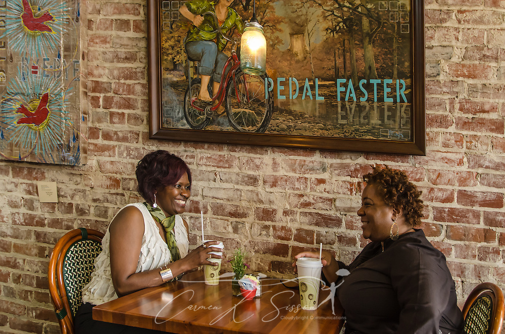 Deneen Banks and Shander Gund talk after lunch at Delta Bistro in Greenwood, Miss. The eclectic eatery showcases local artwork and offers specialties like fried alligator bites and black-eyed pea cakes. (Photo by Carmen K. Sisson)