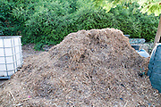 Compost heap. Domestic waste decomposes over time to be recycled as compost.